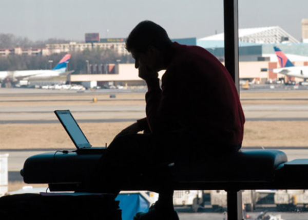 33_Man-on-laptop-in-airport._420
